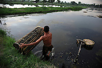 45 year old shrimp farmer Abdul Rahim says most of his shrimps died in 2006 following the mud flow, as mud from the disaster area was piped into the Porong River which indirectly supplies his ponds. Since then his yields have slowly been increasing but are still far lower than the pre-disaster levels. Since May 2006, more than 10,000 people in the Porong subdistrict of Sidoarjo have been displaced by hot mud flowing from a natural gas well that was being drilled by the oil company Lapindo Brantas. The torrent of mud - up to 125,000 cubic metres per day - continued to flow three years later.