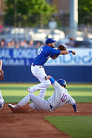 Tulsa Drillers shortstop Luis Mateo (3) throws to first as Chad Pinder (10) slides into second during a game against the Midland RockHounds on June 2, 2015 at Oneok Field in Tulsa, Oklahoma.  Midland defeated Tulsa 6-5.  (Mike Janes/Four Seam Images)
