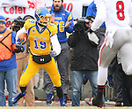 BROOKINGS, SD - NOVEMBER 22:  Jake Wieneke #19 from South Dakota State University looks for extra yardage against the University of South Dakota in the first half of their game Saturday at Coughlin Alumni Stadium in Brookings. (Photo by Dave Eggen/Inertia)