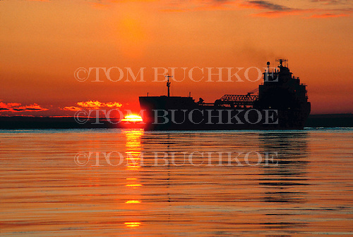 M/V Algoport  with sunrise on Lake Superior, near Marquette, Michigan.