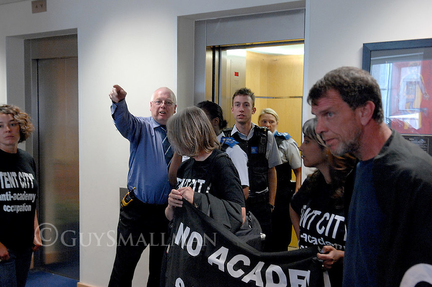 Angry parents and teachers occupy the lobby of an office building housing the ARK group. Protest was over the plans by Brent council to hand over a local sports ground to the company to build a City Acadamy. The Police were called but some CPSOs turned up just as the protesters were leaving.