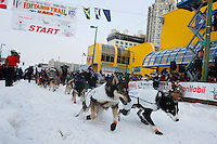 Saturday March 6 , 2010  Cim Smyth leaves the start line during the ceremonial start of the 2010 Iditarod in Anchorage , Alaska
