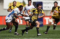 Hurricanes winger Zac Guildford tries to escape his Cheetahs opposite Jongi Nokwe..Super 14 rugby union match, Hurricanes v Cheetahs at Yarrows Stadium, New Plymouth, New Zealand. Saturday 7 March 2009. Photo: Dave Lintott / lintottphoto.co.nz