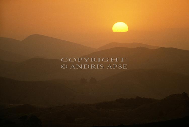 Sun setting over hills in the Masterton area. Wellington Region. New Zealand.