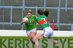 Kerry's Debra Murphy shows great determination to go past Mayo's Helena Lohan in the Fitzgerald Stadium on Sunday