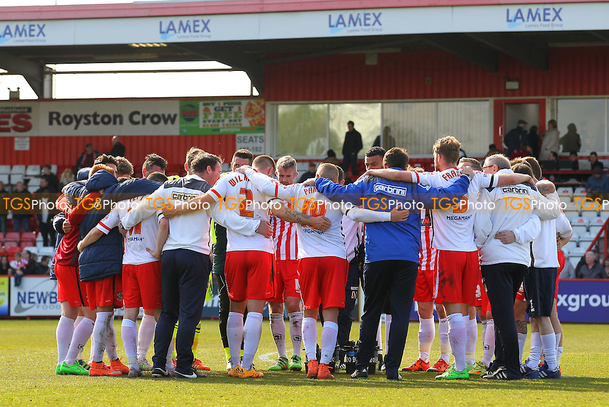 Stevenage players huddle at the final whistle during Stevenage vs AFC Wimbledon, Sky Bet League 2 Football at the Lamex Stadium on 30th April 2016