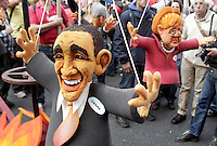 "Manifestazione ""No Monti Day"" contro le politiche economiche e sociali del governo, a Roma, 27 ottobre 2012..Puppets of the U.S. President Barack Obama and German Chancellor Angela Merkel, right, are seen during the ""No Monti Day"" demonstration against government's  financial cuts, in Rome, 27 October 2012..UPDATE IMAGES PRESS/Riccardo De Luca"