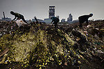 The industrial waste of the Taixing Chemical Industrial Park is heaped along the banks of the Yangtze River. Jiangsu Province. May 15, 2009.