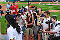 Jun. 23, 2009; Albuquerque, NM, USA; Albuquerque Isotopes outfielder Manny Ramirez walks past the media as he enters the field prior to the game against the Nashville Sounds at Isotopes Stadium. Ramirez is playing in the minor leagues while suspended for violating major league baseballs drug policy. Mandatory Credit: Mark J. Rebilas-