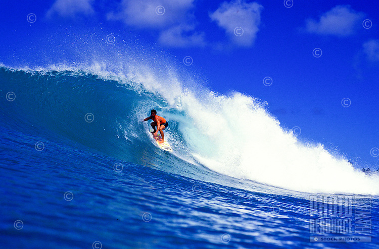 Surfer rides a big wave at world famous Pipeline beach at the North Shore, Oahu