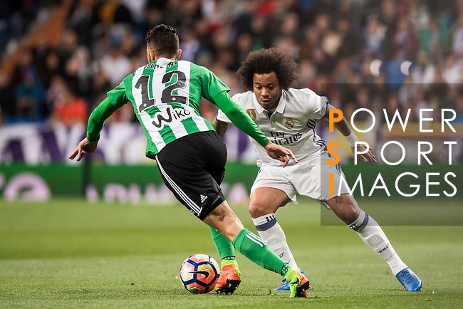 Marcelo Vieira Da Silva of Real Madrid battles for the ball with Cristiano Piccini of Real Betis during their La Liga match between Real Madrid and Real Betis at the Santiago Bernabeu Stadium on 12 March 2017 in Madrid, Spain. Photo by Diego Gonzalez Souto / Power Sport Images