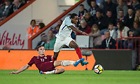 Kyle Walker-Peters (Tottenham Hotspur) of England U21 rides an Raivis Andris Jurkovskis (Liepaja) of Latvia U21 challenge during the UEFA EURO U-21 First qualifying round International match between England 21 and Latvia U21 at the Goldsands Stadium, Bournemouth, England on 5 September 2017. Photo by Andy Rowland.