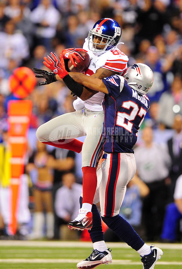 Feb 5, 2012; Indianapolis, IN, USA; New York Giants wide receiver Hakeem Nicks (88) catches a pass against New England Patriots cornerback Antwaun Molden (27) during the first half of Super Bowl XLVI at Lucas Oil Stadium.  Mandatory Credit: Mark J. Rebilas-