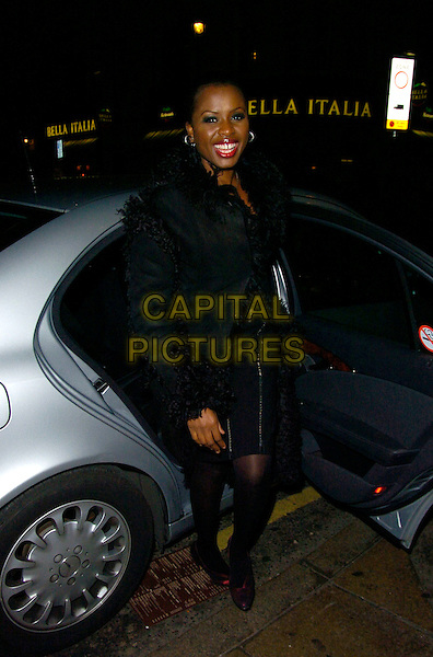 JUNE SARPONG.June Sarpong's T4 leaving party, Movida bar & nightclub, London, England..December 20th, 2007.full length black coat dress fur  lined trim car.CAP/CAN.©Can Nguyen/Capital Pictures