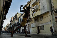 A young Cuban boy plays baseball, using a broomstick and a bottle cap, on the street of Havana, Cuba, 16 August 2008. About 50 years after the national rebellion, led by Fidel Castro, and adopting the communist ideology shortly after the victory, the Caribbean island of Cuba is the only country in Americas having the communist political system. Although the Cuban state-controlled economy has never been developed enough to allow Cubans living in social conditions similar to the US or to Europe, mostly middle-age and older Cubans still support the Castro Brothers' regime and the idea of the Cuban Revolution. Since the 1990s Cuba struggles with chronic economic crisis and mainly young Cubans call for the economic changes.