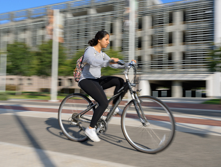 Students zip to class on one of the <br /> many campus bike paths