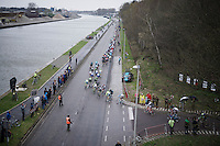 peloton races alongside the canal<br /> <br /> 104th Scheldeprijs 2016