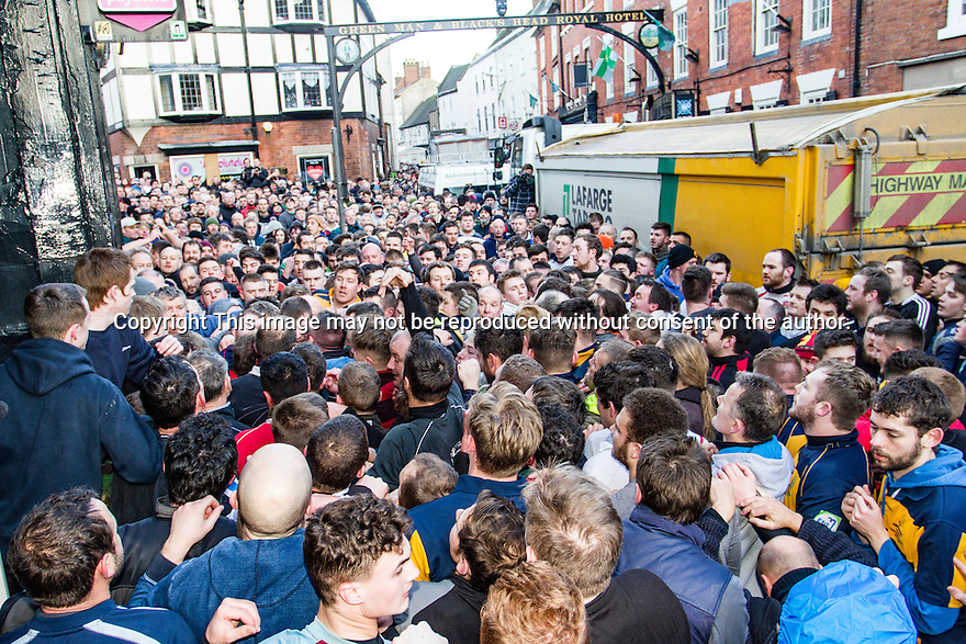 09/02/16 <br /><br />Today (Tuesday), the annual game of Shrovetide football is played out across the Derbyshire town of Ashbourne between the Up'ards and Down'ards. The two day event is held every Shrove Tuesday and Ash Wednesday, attracting attracts over 2000 visitors to the game that is alleged to have been started in the 11th Century under the reign of William the Conquerer. Here, in the middle of the town, traffic has been brought to a halt as the main 'Hug, Shrovetide players and supporters make their way through the town.<br /><br />All Rights Reserved: F Stop Press Ltd. +44(0)1335 418365   +44 (0)7765 242650 www.fstoppress.com