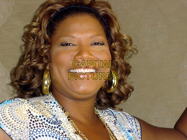 "QUEEN LATIFAH.Photocall for ""Hairspray"", The Four Seasons, California, USA..June 15th, 2007.headshot portrait gold hoop earrings .CAP/AW.©Anita Weber/Capital Pictures"
