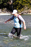 NELSON LAKES, NEW ZEALAND - APRIL 18:  Sandra Skudder crosses the Travers River during the 2015 Alpine Lodge Loop The Lake trail run at Lake Rotoiti on April 18 16, 2015 in Nelson, New Zealand. (Photo by Marc Palmano/Shuttersport Limited)
