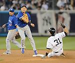 (R-L) Ichiro Suzuki (Yankees), Munenori Kawasaki, Maicer Izturis (Blue Jays),.APRIL 26, 2013 - MLB :.Ichiro Suzuki of the New York Yankees and Munenori Kawasaki of the Toronto Blue Jays during the baseball game against the Toronto Blue Jays at Yankee Stadium in The Bronx, New York, United States. (Photo by AFLO)