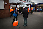A programme seller outside the entrance to Victory Park, before Chorley played Altrincham in a Vanarama National League North fixture. Chorley were founded in 1883 and moved into their present ground in 1920. The match was won by the home team by 2-0, watched by an above-average attendance of 1127.