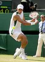 30-6-06,England, London, Wimbledon, third round match,  Max Mirnyi