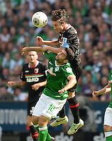 FUSSBALL   1. BUNDESLIGA   SAISON 2013/2014   2. SPIELTAG SV Werder Bremen - FC Augsburg       11.08.2013 Mehmet Ekici (li, SV Werder Bremen) gegen Paul Verhaegh (re, FC Augsburg)