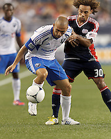 Montreal Impact forward Marco Di Vaio (9) attempts to control the ball on a throw in as New England Revolution defender Kevin Alston (30) defends. In a Major League Soccer (MLS) match, Montreal Impact defeated the New England Revolution, 1-0, at Gillette Stadium on August 12, 2012.