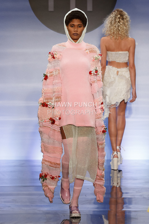 Model walks runway in an outfit by Zoe Whalen, during the Future of Fashion 2017 runway show at the Fashion Institute of Technology on May 8, 2017.