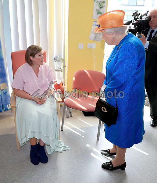 25 May 2017 - Queen Elizabeth II speaks to Ruth Murrell who was injured, along with her daughter Emily, 12, during a visit to the Royal Manchester Children's Hospital to meet victims of the terror attack in the city earlier this week and to thank members of staff who treated them. Photo Credit: ALPR/AdMedia