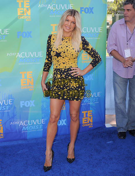 Stacy Ferguson Duhamel aka Fergie of Black Eyed Peas.The Fox 2011 Teen Choice Awards held at Gibson Ampitheatre in Universal City, California, USA..August 7th, 2010                    .full length black yellow stars print hair highlights roots beauty blonde dress clutch bag hand on hip.CAP/RKE/DVS.©DVS/RockinExposures/Capital Pictures.
