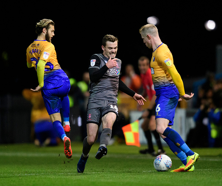 Lincoln City's Harry Toffolo vies for possession with Mansfield Town's Jorge Grant, left, and Mansfield Town's Neal Bishop<br /> <br /> Photographer Chris Vaughan/CameraSport<br /> <br /> The EFL Sky Bet League Two - Mansfield Town v Lincoln City - Monday 18th March 2019 - Field Mill - Mansfield<br /> <br /> World Copyright © 2019 CameraSport. All rights reserved. 43 Linden Ave. Countesthorpe. Leicester. England. LE8 5PG - Tel: +44 (0) 116 277 4147 - admin@camerasport.com - www.camerasport.com