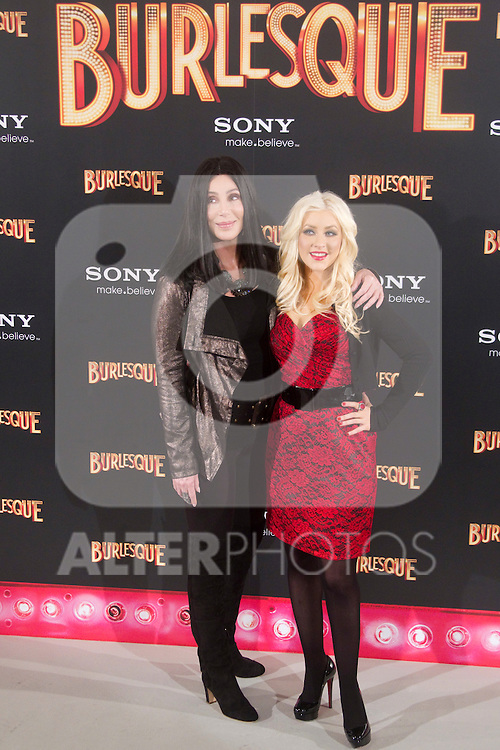 Singers and actresses Cher and Christina Aguilera attend 'Burlesque' photocall at Villamagna Hotel on December 9, 2010 in Madrid, Spain....Photo. Cesar Cebolla / ALFAQUI