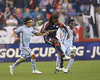 New England Revolution midfielder Shalrie Joseph (21) passes under pressure. The New England Revolution tied the Colorado Rapids, 1-1, at Gillette Stadium on May 16, 2009.