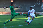 Palestinian football players of Al-Sadaqa club (green) and Gaza Sports Club team (White) compete during match premier League in Palestine stadium, in Gaza City, on October 14, 2019. Photo by Mahmoud Ajjour