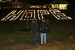 "SOUTHBURY, CT 01/01/08-010108BZ03- A few people look at the word ""HOPE"" spelled out in luminaries on the lawn outside Sacred Heart Church in Southbury Tuesday night.   The vigil was in remembrance of youth from the area who had untimely deaths recently.<br /> Jamison C. Bazinet Republican-American"