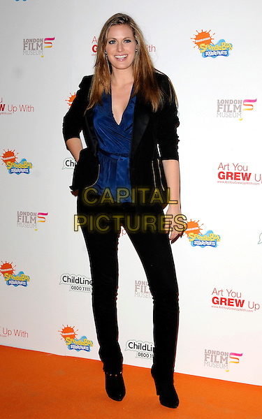 OLIVIA LEE.Attending the charity auction of SpongeBob SquarePants Artwork, London, England. .January 21st, 2010.full length black jacket blue lace cleavage low cut v-neck hand on hip ankle boots jeans .CAP/CAN.©Can Nguyen/Capital Pictures.