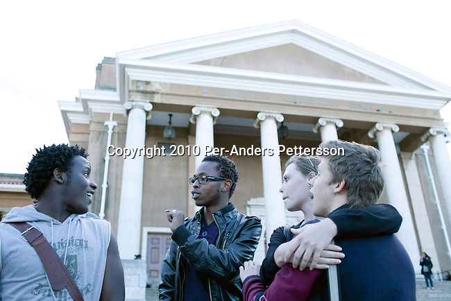 CAPE TOWN, SOUTH AFRICA - OCTOBER 12: Affluent student Sam Mgobozi (c), age 19, talks to a friend  on the University of Cape Town campus on October 12, 2010, in Cape Town, South Africa. Despite over sixteen years or democracy in South Africa, racial relations are still tense and the University Many students only interact with friends of their own race and many black students struggle to get in or finish their studies due to lack of money and a history of bad education for blacks in the country.  (Photo by Per-Anders Pettersson/Getty Images).