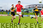 Liam Kearney, East Kerry in action against Michael Potts, Dr Crokes  during the Kerry County Senior Club Football Championship Final match between East Kerry and Dr. Crokes at Austin Stack Park in Tralee, Kerry.