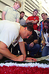 Ole Miss Head Football Coach Ed Orgeron takes time after practice Wed., Mar. 23, 2005 to sign autographs for a few of the hundreds of students that showed up at the Indoor Practice Facility to watch the Ole Miss spring practice. Photo by Nathan Latil/Ole Miss Communications