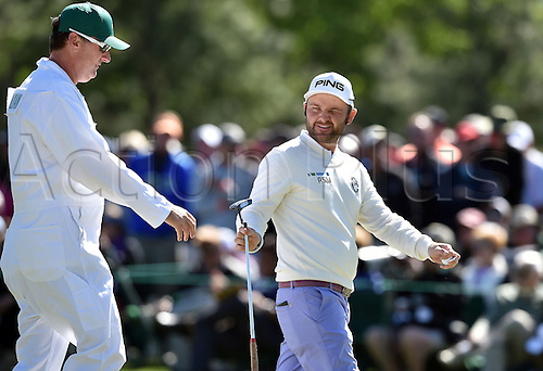 07.04.2016. Augusta, GA, USA. Andy Sullivan walks off on the second green, with his caddie, Sean McDonagh, during the first round of the Masters Golf Tournament on Thursday, April 7, 2016, at Augusta National Golf Club in Augusta, Ga