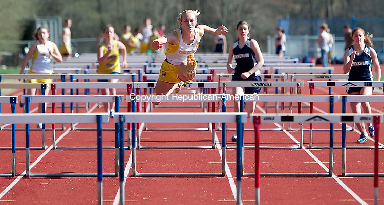 WOODBURY, CT- 23 APRIL 07- 042307JT10-<br /> Thomaston's Jill Sabol races ahead of (left to right) teammate Danielle Eichman, Gilbert's Courtney Toomey, and Nonnewaug's Ariana Skipp and Mallory Beck during the 100 meter hurdle event at Tuesday's track meet at Nonnewaug.<br /> Josalee Thrift Republican-American