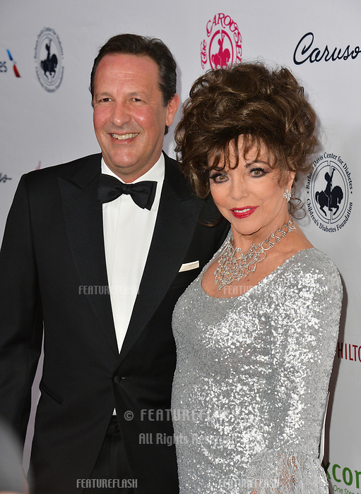 LOS ANGELES, CA. October 06, 2018: Joan Collins & Percy Gibson  at the 2018 Carousel of Hope Ball at the Beverly Hilton Hotel.<br /> Picture: Paul Smith/Featureflash
