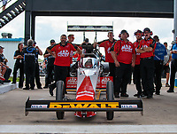 Oct 6, 2018; Ennis, TX, USA; NHRA top fuel driver Doug Kalitta with crew members during qualifying for the Fall Nationals at the Texas Motorplex. Mandatory Credit: Mark J. Rebilas-USA TODAY Sports