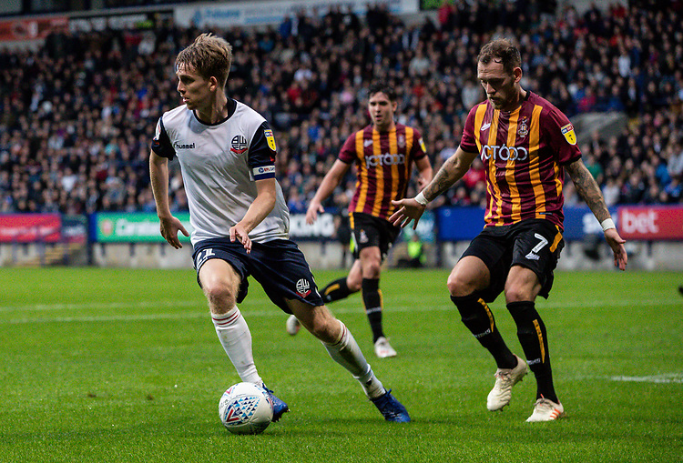 Bolton Wanderers' Harry Brockbank competing with Bradford City's Harry Pritchard (right) <br /> <br /> Photographer Andrew Kearns/CameraSport<br /> <br /> EFL Leasing.com Trophy - Northern Section - Group F - Bolton Wanderers v Bradford City -  Tuesday 3rd September 2019 - University of Bolton Stadium - Bolton<br />  <br /> World Copyright © 2018 CameraSport. All rights reserved. 43 Linden Ave. Countesthorpe. Leicester. England. LE8 5PG - Tel: +44 (0) 116 277 4147 - admin@camerasport.com - www.camerasport.com