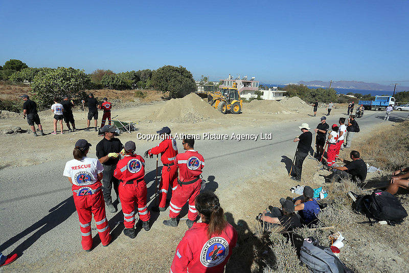 Pictured: Forensic archaeologists assisted by a digger, work at the second site in Kos, Greece. Sunday 16 October 2016<br />