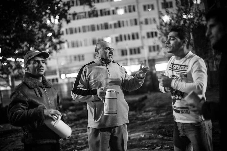 Andras Baltescu, center, is a former homeless alcoholic who joined the Victory Outreach church and got clean. Now he goes with other volunteers to offer tea and advice to the drug addicted youth who gather near Gara de Nord in Bucharest. Left is Ion Mindru who volunteers in the soup kitchen at Victory Outreach.
