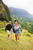 Happy couple trail hiking in Windward Oahu.