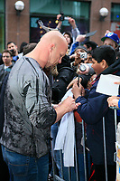 Stone Cold Steve Austin signs autographs for fans at the red carpet Canadian premiere of his first feature film, The Condemned at the ScotiaBank Theatre in Toronto.(CNW Group/World Wrestling Entertainment Canada, Inc.)